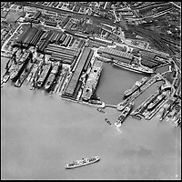 BNPS.co.uk (01202 558833)<br /> Pic: Aerofilms/HistoricEngland/BNPS<br /> <br /> Cammell Laird Birkenhead, 29 June 1950.<br /> <br /> Stunning historic aerial photos of seaside towns, naval bases, ports and shipyards which tell the story of Britain's once-great maritime tradition feature in a new book.<br /> <br /> The fascinating archive of black and white images includes views from a bygone age such as Brighton's famous West Pier, Grimsby's burgeoning fishing fleet, and London's dock yards.<br /> <br /> Iconic ships were also captured from the skies including the Cutty Sark in its final seaworthy years on the Thames, HMY Britannia in 1959, the RMS Queen Mary in 1946 and the SS Queen Elizabeth in 1969 about to make her maiden voyage.<br /> <br /> England's Maritime Heritage from the Air, by Peter Waller, is published by English Heritage and costs &pound;35.