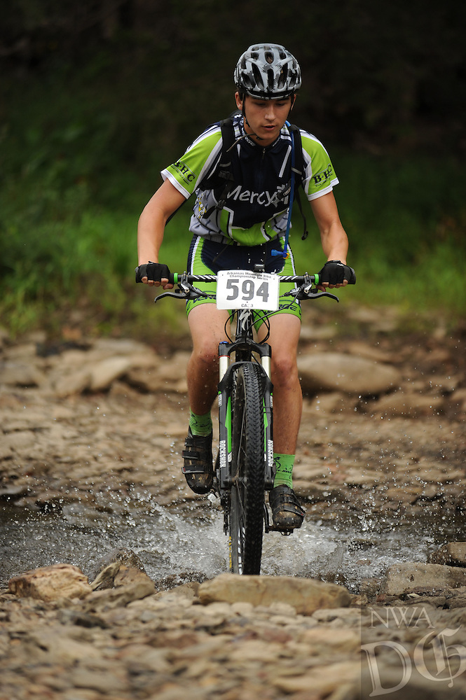 NWA Democrat-Gazette/ANDY SHUPE<br /> Max Pollah of Fort Smith rides across Lee Creek Saturday, Sept. 19, 2015, during the Northwest Arkansas Mountain Bike Championships at Devil's Den State park.