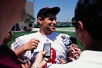 SANTA CLARA, CA - Quarterback Steve Young of the San Francisco 49ers talks to the media after practice at the 49ers facility in Santa Clara, California in 1996. Photo by Brad Mangin