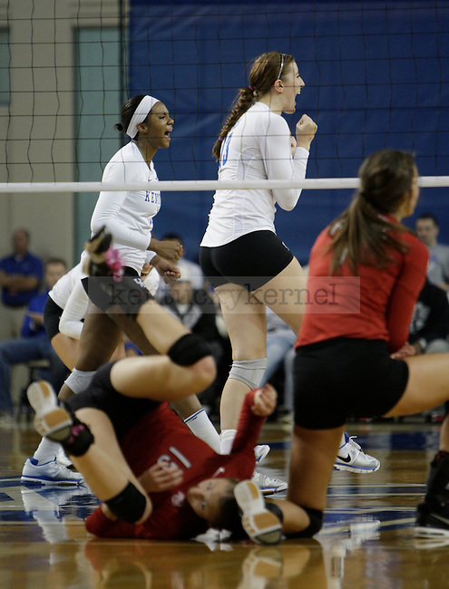 The team celebrates after a point during the UK women's volleyball game v. Ohio University during the second round of the NCAA tournament in Memorial Coliseum in Lexington, Ky., on Saturday, December 1, 2012. Photo by Genevieve Adams | Staff