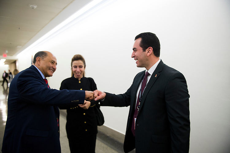 UNITED STATES - DECEMBER 1: Rep.-elect Lou Correa, D-Calif., left, gives Rep.-elect Ruben Kihuen, D-Nev., a fist bump in the basement of the Longworth House Office Building after the New Member Orientation Room Lottery Draw for office space at the Capitol on December 1, 2016. Correa won first pick of office space while Kiuhen gets the 30th pick. (Photo By Bill Clark/CQ Roll Call)