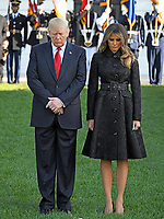 United States President Donald J. Trump and first lady Melania Trump bow their heads as they lead a moment of silence in remembrance of those lost on September 11, 2001 on the South Lawn of the White House in Washington, DC on Monday, September 11, 2017.<br /> CAP/MPI/CNP/RS<br /> &copy;RS/CNP/MPI/Capital Pictures