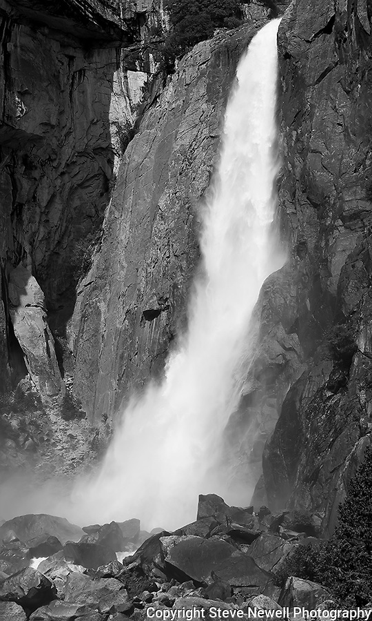 """Lower Yosemite Falls Waterfall"" Yosemite National Park, California.  I love Black and White photographs of Yosemite.  Ansel Adams is one of my photography heros. I was in Yosemite for a week in March and a week in April during the Spring of 2013. Due to the light winter snow fall I went earlier than normal to capture the waterfalls while they were still flowing pretty good. Sunsets in Yosemite really bring out the spectacular colors of the rock formations."
