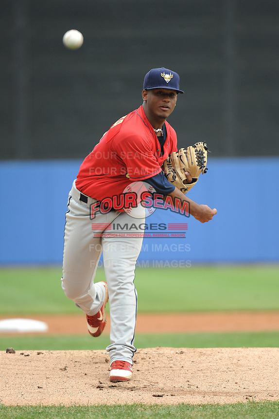 State College Spikes pitcher Juan Bautista (23) during game against the Staten Island Yankees at Richmond County Bank Ballpark at St.George on August 8, 2013 in Staten Island, NY.  Staten Island defeated State College 6-5.  (Tomasso DeRosa/Four Seam Images)