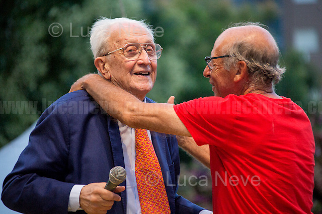 """Judge Ferdinando Imposimato & Salvatore Borsellino.<br /> <br /> Palermo (Sicily - Italy), 19/07/2017. """"Basta depistaggi e omertà di Stato!"""" (""""Stop disinformation & omertá by the State!"""")(1). Public event to commemorate the 25th Anniversary of the assassination of the anti-mafia Magistrate Paolo Borsellino along with five of his police """"scorta"""" (Escorts from the special branch of the Italian police force who protect Judges): Agostino Catalano, Emanuela Loi (The first Italian female member of the police special branch and the first woman of this branch to be killed on duty), Vincenzo Li Muli, Walter Eddie Cosina and Claudio Traina. The event was held at Via D'Amelio, the road where Borsellino was killed. Family members of mafia victims, amongst others, made speeches about their dramatic experiences, mafia violence and unpunished crimes, State cover-ups, silence ('omertá'), and misinformation. Speakers included, amongst others, Vincenzo Agostino & Augusta Schiera, Salvatore & Cristina Catalano, Graziella Accetta, Massimo Sole, Paola Caccia, Luciano Traina, Angela Manca, Stefano Mormile, Ferdinando Imposimato, Judge Nino Di Matteo. The event ended with the screening of the RAI docu-fiction, 'Adesso Tocca A Me' ('Now it's My Turn' - Watch it here: http://bit.ly/2w3WJUX ).<br /> <br /> For more info & a video of the event please click here: http://bit.ly/2eQfNT3 & http://bit.ly/2eQbmrj & http://19luglio1992.com & http://bit.ly/2he8hCj<br /> <br /> (1) 'Omerta' is the term used in Italy to refer to the code of silence used by mafia organisations, as well as the culture of silence that is entrenched in society at large (especially among victims of mafia crimes, as they fear recriminations), about the existence of organised crime and its activities."""