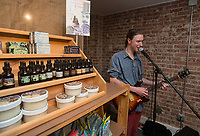 NWA Democrat-Gazette/BEN GOFF @NWABENGOFF<br /> Mike Kinkle of Rogers plays music Thursday, Nov. 9, 2017, at Serenity Naturals, a new natural skincare and bath products business which opened today, during the first Art on the Bricks event in downtown Rogers. More than 20 downtown Rogers businesses participated in the walk, hosting pop-up galleries, artist receptions and live music in what is planned as a regular event on the second Thursday of each month from 4:30p.m. to 6:30p.m.