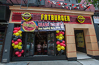 "Burger lovers from far and wide descend on the new Fatburger restaurant in the Murray Hill neighborhood of  New York on its grand opening day, Tuesday, June 11, 2013. The popular West Coast chain, which has a cultish following, opened its first New York outpost  bringing their grilled to order menu with their signature collection of toppings to the East Coast. The fast casual restaurant is popular with celebrities and a loyal fan base and started in Hollywood in 1952.  the company uses ""The Last Great Hamburger Stand""  as their motto and the New York restaurants, a total of ten are planned, will be run by the franchisee, the Riese Organization. (© Richard B. Levine)"