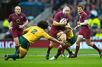 Thomas Waldrom of England is tackled by Tatafu Polota Nau of Australia during the Cook Cup between England and Australia, part of the QBE International series, at Twickenham on Saturday 17th November 2012 (Photo by Rob Munro)