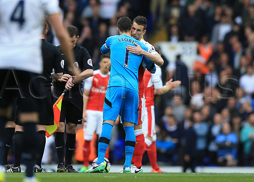 April 30th 2017, White Hart Lane, Tottenham, London England; EPL Premier League football Tottenham Hotspur versus Arsenal; Laurent Koscielny of Arsenal hugs Goalkeeper Hugo Lloris of Tottenham Hotspur before kick off