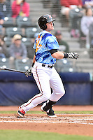 Richmond Flying Squirrels shortstop Christian Arroyo (22) swings at a pitch during a game against the Hartford Yard Goats at The Diamond on April 30, 2016 in Richmond, Virginia. The Yard Goats defeated the Flying Squirrels 5-1. (Tony Farlow/Four Seam Images)