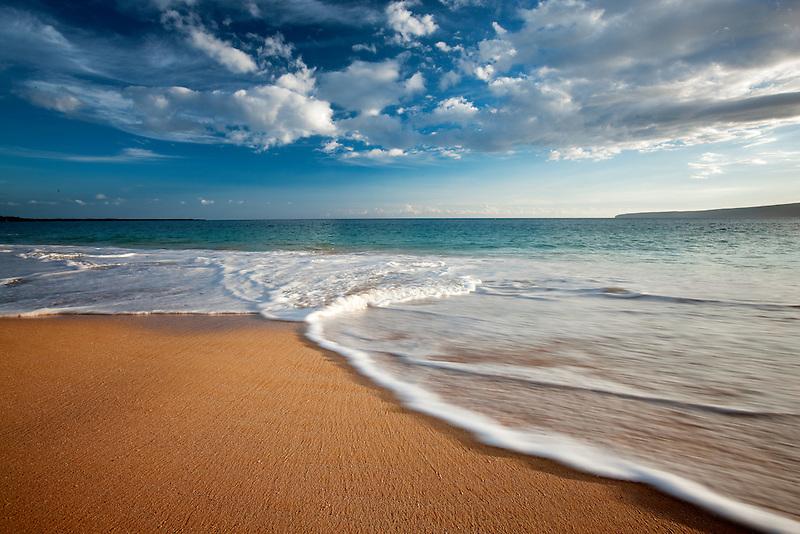 Beach, wave and clouds. Maui, Hawaii.