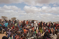 Kenya - Dadaab - Somali refugees who have just arrived at Dadaab refugee camp wait for registration at the UNHCR office.