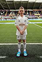 SWANSEA, WALES - FEBRUARY 21: Child mascot prior to the Barclays Premier League match between Swansea City and Manchester United at Liberty Stadium on February 21, 2015 in Swansea, Wales.