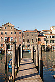 ITALY, Venice. A boat dock along a canal in the Castello distict. Castello is the largest of the six sestieri of Venice.