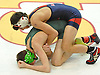 Nick Goodelman of MacArthur, top, battles Eric Brach of Bellmore JFK at 113 pounds during the Nassau County Division 1 wrestling quarterfinals at Hofstra University on Saturday, Feb. 13, 2016. Goodelman won by pin at 5:03.