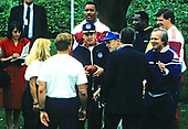 Former Washington Redskins head coach George Allen (holding the football at center) participates in the kick-off of the Great American Workout Month hosted by United States President George H.W. Bush first lady Barbara Bush on the South Lawn of the White House in Washington, D.C. on May 1, 1990.  Also pictured are Washington Redskins defensive end Charles Mann, and Washington Redskins offensive tackle Jim Lachey.  The New York Post Washington bureau chief Deborah Orin is pictured at far left.<br /> Credit: Howard L. Sachs / CNP