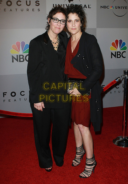 LISA COLEMAN & WENDY MELVOIN.NBC Universal 68th Annual Golden Globe Awards After Party held at the Beverly Hilton, Beverly Hills, California, USA..January 16th, 2011.full length black suit jacket red dress glasses Girl Bros..CAP/ADM/KB.©Kevan Brooks/AdMedia/Capital Pictures.