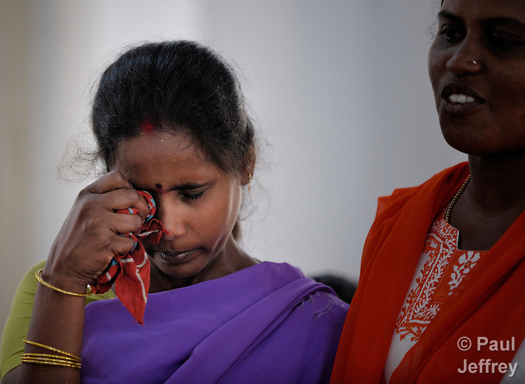 Venkaka Lakshmi (left) cries after sharing with participants in a support group for HIV positive people at the Gurukul  Lutheran Theological College in Chennai, India. At her side is Vijaya Stella, a social worker for the National Lutheran Health and Medical Board. (Note restriction on use in Special Instructions below.)