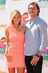 LOS ANGELES, CA- JULY 17: Surfer Bethany Hamilton (L) and her husband Adam Dirks arrive Nickelodeon Kids' Choice Sports Awards 2014 at Pauley Pavilion on July 17, 2014 in Los Angeles, California.