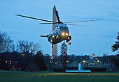 Marine 1, with United States President Barack Obama aboard, lands on the South Lawn of the White House in Washington, D.C. on Thursday, March 26, 2015.  The President is returning from a trip to Birmingham, Alabama, where he hosted a roundtable and delivered remarks on the economy.<br /> Credit: Ron Sachs / Pool via CNP