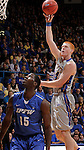 SIOUX FALLS, SD - MARCH 11:  Tony Fiegen #34 of South Dakota State shoots over Mario Hines #15 of IPFW during their semi-final game at the 2013 Summit League Basketball Championships Monday at the Sioux Falls Arena.  (Photo by Dick Carlson/Inertia)