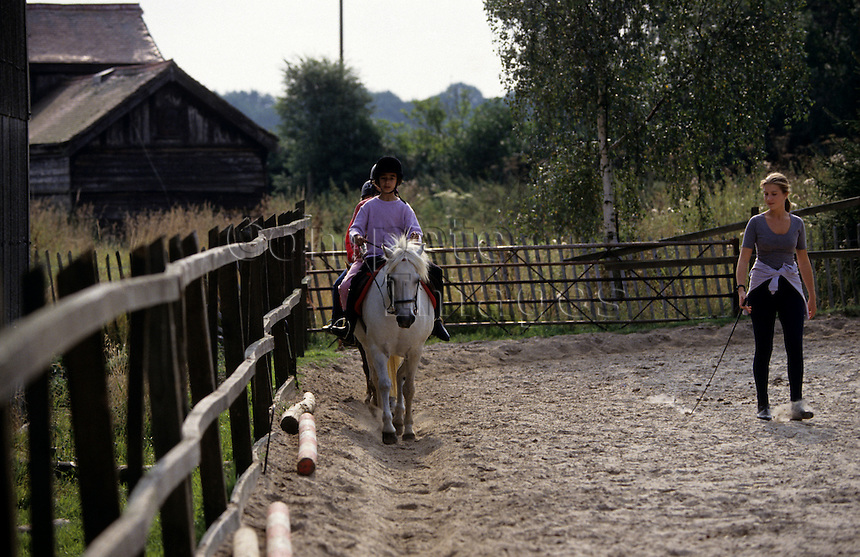 Girl receiving a schooling lesson
