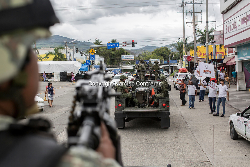 "June 17, 2018: A military convoy surveils ""Zapata/Renacimiento"" vicinity, violence-plagued neighbourhoods in Acapulco, Guerrero. A juncture of security forces, among them military, marines, federal police and local police joined under one-command to fight crime violence in the once-glamorous resort destination."