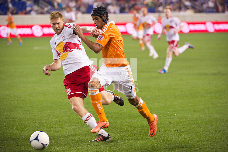 Markus Holgersson (5) of the New York Red Bulls battle sCalen Carr (3) of the Houston Dynamo for the ball. The New York Red Bulls defeated the Houston Dynamo 1-0 during a Major League Soccer (MLS) match at Red Bull Arena in Harrison, NJ, on May 09, 2012.