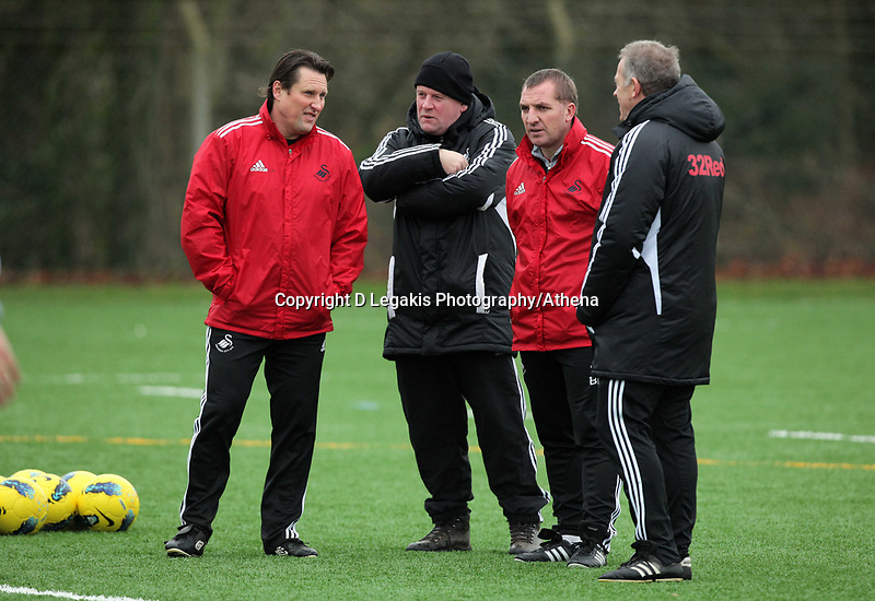 FAO SPORTS PICTURE DESK<br /> Pictured: Manager Brendan Rodgers (3rd L) with coaching staff Colin Pascoe, Huw Lakey and Alan Curtis. Thursday 12 January 2012<br /> Re: Premier League football side Swansea City FC training session at Llandarcy, south Wales.