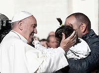 Papa Francesco saluta una bambina al termine di un'udienza giubilare in Piazza San Pietro, Citta' del Vaticano, 12 novembre 2016.<br /> Pope Francis greets a child at the end of a Jubilee Audience in St. Peters Square at the Vatican, November 12, 2016.<br /> UPDATE IMAGES PRESS/Isabella Bonotto<br /> <br /> STRICTLY ONLY FOR EDITORIAL USE