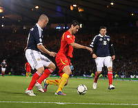 Kenny Miller pressures Vanche Shikov in the Scotland v Macedonia FIFA World Cup Qualifying match at Hampden Park, Glasgow on 11.9.12. .