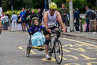 COPY BY TOM BEDFORD<br /> Sunday 26 June 2016<br /> Pictured: Poppy and dad Rob during the Cycle section of the event <br /> Re: A very special father-and-daughter team have tackled the Cardiff Triathlon.<br /> Poppy Jones, 11, who will be competing alongside dad Rob Jones, wants to win the event.<br /> And she's not going to let the fact that she has quadriplegic cerebral palsy , which means she can't sit, stand, roll or support herself, and chronic lung disease stop her.<br /> She will be by Rob's side every step of the way thanks to a cutting-edge wheelchair and boat – for Rob to push or pull – designed especially for the event, which sees participants take part in a swim across Cardiff Bay , a run and a bike ride.