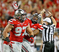 Ohio State Buckeyes defensive lineman Joey Bosa (97) is congratulated by teammate Ohio State Buckeyes linebacker Darron Lee (43) after tackling Virginia Tech Hokies quarterback Michael Brewer (12) and causing a fumble recovered by Ohio State Buckeyes defensive lineman Rashad Frazier (17) during Saturday's NCAA Division I football game at Ohio Stadium in Columbus on September 6, 2014. Virginia Tech won the game 35-21. (Dispatch Photo by Barbara J. Perenic)