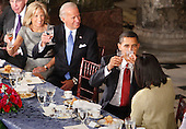 Washington, DC - January 20, 2009 -- United States President Barack Obama, raises his glass for a toast with first lady Michelle Obama as Vice President Joe Biden and his wife Jill smile at the end  of their lunch at Statuary Hall in the U.S. Capitol  in Washington, Tuesday, January  20, 2009. .Credit: Lawrence Jackson - Pool via CNP