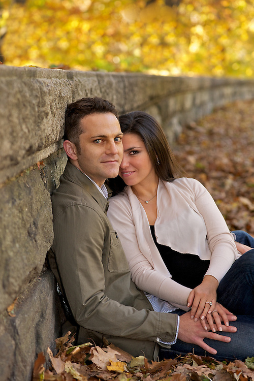 A romantic portrait of a couple in Riverside Park with fall foliage.