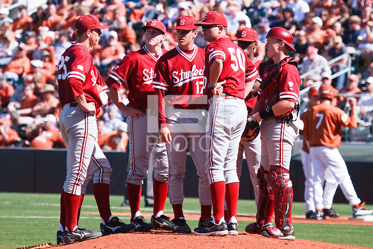 AUSTIN, TEXAS-March 6, 2011:  Pitching Coach Rusty Filter of Stanford presides over a mound conference during the game against the Texas Longhorns, at Disch-Falk field in Austin, Texas.  Texas defeated Stanford 4-2.