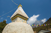 Nepal Himalayas stupa stands in the village of Phurte with prayer flags and himalayan mountain in the background