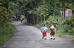 "Two girls run to school in Tugala, a village on the Indonesian island of Nias. The village was struck by both a 2004 tsunami and a 2005 earthquake, leaving houses destroyed and lives disrupted. The ACT Alliance helped villagers here to construct new homes and latrines, build a potable water system, open a clinic and schools and get their lives going once again. For the residents of Tugala, the post-disaster mantra of ""build back better"" became a reality with help from the ACT Alliance."