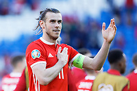 Gareth Bale of Wales thanks home supporters during the UEFA EURO 2020 Qualifier match between Wales and Slovakia at the Cardiff City Stadium, Cardiff, Wales, UK. Sunday 24 March 2019