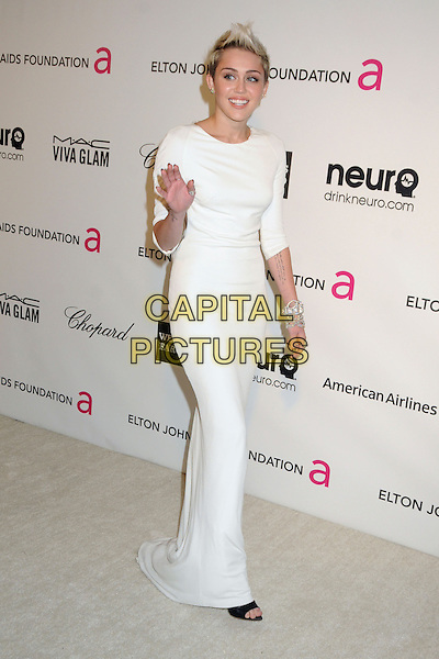 Miley Cyrus (wearing Azzaro).21st Annual Elton John Academy Awards Viewing Party held at West Hollywood Park, West Hollywood, California, USA..February 24th, 2013.oscars full length dress white long sleeves diamond bracelets hand arm waving .CAP/ADM/BP.©Byron Purvis/AdMedia/Capital Pictures.