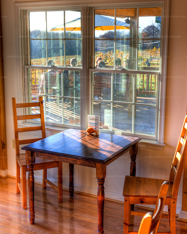 A window table in the tasting room overlooks the deck and terrific views outside, in the tasting room of the Winery at Fox Meadow.  (HDR image)
