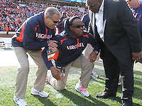 Oct 30, 2010; Charlottesville, VA, USA;   Virginia Cavaliers head coach Mike London, middle, gets emotional after the 24-19 upset win over the Miami Hurricanes at Scott Stadium. Mandatory Credit: Andrew Shurtleff