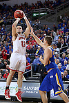 SIOUX FALLS, SD: MARCH 6: Matt Mooney #13 from the University of South Dakota spots up for a jumper over Lane Severyn #25 from South Dakota State University during the Summit League Basketball Championship on March 6, 2017 at the Denny Sanford Premier Center in Sioux Falls, SD. (Photo by Dave Eggen/Inertia)