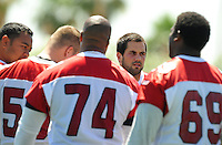 Jun 9, 2008; Tempe, AZ, USA; Arizona Cardinals quarterback Matt Leinart talks to his players in a huddle during mini camp at the Cardinals practice facility. Mandatory Credit: Mark J. Rebilas-