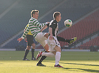 Jackson Irvine gets a foot in to stop Allan Smith in the Dunfermline Athletic v Celtic Scottish Football Association Youth Cup Final match played at Hampden Park, Glasgow on 1.5.13. ..