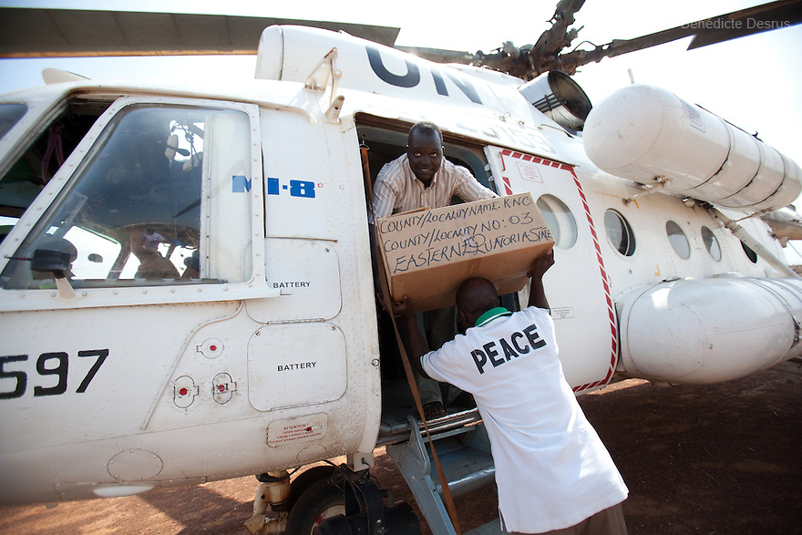 For UNMIS / Sudan<br /> <br /> Training officers for the Southern Sudan Referendum Commission unload completed registration materials next to a UNMIS helicopter in Riwoto, Eastern Equatoria State, South Sudan. The UNMIS retrieves completed registration materials in Riwoto - Kapoeta North County, the day after registration for South Sudan's referendum closed. The referendum is scheduled to take place on January 9, 2010. Photo credit: Benedicte Desrus