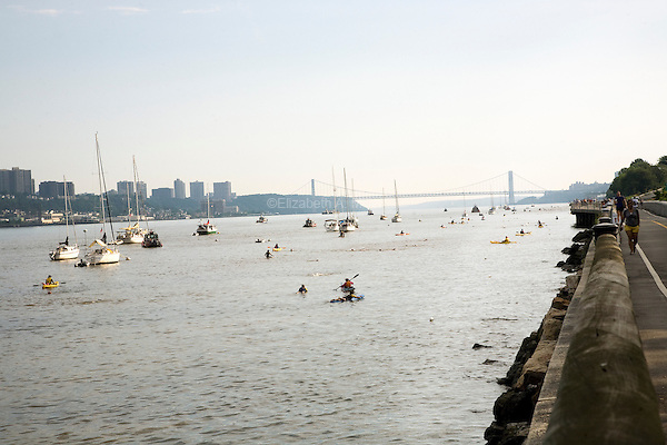 Lifeguards and other safety officials line the swimming course in the Hudson River during the Aquaphor New York City Triathlon in New York on July 8, 2012.
