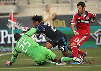 CHESTER, PA - AUGUST 12, 2012:  Sheanon Williams (25) of the Philadelphia Union crashes into  Sean Johnson (25) of the Chicago Fire during an MLS match at PPL Park, in Chester, PA on August 12. Fire won 3-1.
