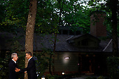 United States President Barack Obama greets Italian Prime Minister Mario Monti in front of Laurel Lodge at Camp David during the 2012 G8 Summit on Friday, May 18, 2012 in Camp David, Maryland. Leaders of eight of the worlds largest economies meet over the weekend in an effort to keep the lingering European debt crisis from spinning out of control.  .Credit: Luke Sharrett / The New York Times / Pool via CNP