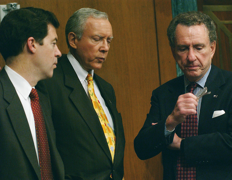3/14/02.PICKERING NOMINATION--During a break in the Senate Judiciary meeting on the nomination of Charles W. Pickering Sr. to be United States Circuit Court Judge for the 5th Circuit, Sen. Sam Brownback, R-Kan., ranking Republican Orrin G. Hatch, R-Utah, and Sen. Arlen Specter, R-Pa., talk..CONGRESSIONAL QUARTERLY PHOTO BY SCOTT J. FERRELL